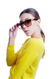 Stylish beautiful woman in sunglasses and yellow sweater Royalty Free Stock Image