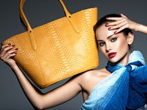 Free Stylish Beautiful  Woman Wearing Blue Scarf  With Yellow Handbag Stock Image - 166175471