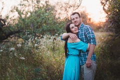 Stylish beautiful young couple standing outdoors at sunset light Royalty Free Stock Photo