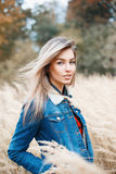 Stylish beautiful young woman in jeans jacket with fur. Stock Images