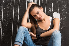 Stylish beautiful young woman looks forward Royalty Free Stock Images