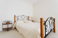 Stylish bed in a bedroom stock photography