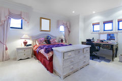 Stylish bedroom. With drawers and classic desk Stock Images