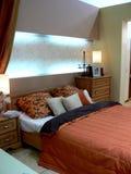 Stylish bedroom. With big bed and beautiful illumination Royalty Free Stock Photos