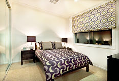 Stylish bedroom with abstract designs and dark light lamps Royalty Free Stock Photo