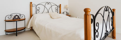 Stylish bedroom with elegant bed Stock Image