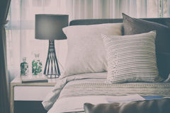 Stylish bedroom interior design with brown patterned pillows on bed Royalty Free Stock Photography