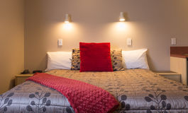 Stylish bedroom interior design with red velvet Stock Images