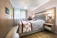 Stylish bedroom interior design. In rose finishing Stock Photos
