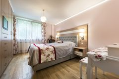 Stylish bedroom interior design. In rose finishing Royalty Free Stock Photos