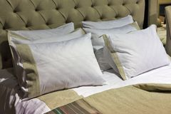Stylish bedroom interior with pillows on bed Royalty Free Stock Photography