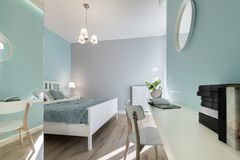Stylish bedroom with mirror wal. L in pastel colors Royalty Free Stock Image