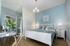 Stylish bedroom with mirror wal. L in pastel colors Royalty Free Stock Photo
