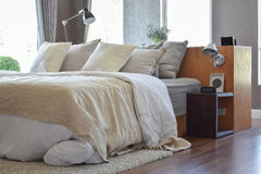 Stylish bedroom with white striped pillows on bed Royalty Free Stock Photo