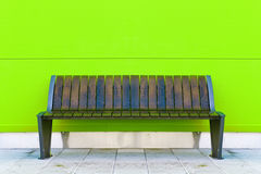 Stylish bench against green wall Stock Photography