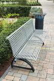 Stylish bench and metal trash can. In the park for rest stock photo