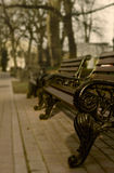 Stylish bench in spring park. Vintage style Royalty Free Stock Images