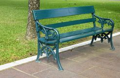 Stylish bench in summer park Royalty Free Stock Image