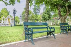 Stylish bench in summer park Royalty Free Stock Images