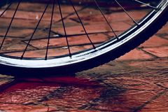 A stylish bicycle tyre on a wet surface photograph stock image