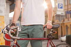Stylish biker with vintage race bike Royalty Free Stock Image