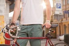 Stylish biker with vintage race bike Royalty Free Stock Image