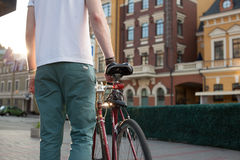 Stylish biker with vintage race bike Stock Photography