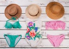 Stylish bikini set and hats. Stock Photos