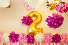 Stylish Birthday decorations for little girl on her second birthday. Birthday party for child second years old. Pink and golden colors. Stylish Birthday Royalty Free Stock Image