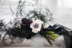 Stylish black bouquet tied with a black ribbon on a white cloth Stock Photography
