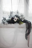 Stylish black bouquet tied with a black ribbon on a white cloth Stock Images