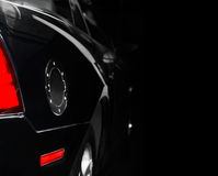 Stylish black car. Stylish black car with chrome round lid of a fuel tank Royalty Free Stock Images