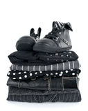 Stylish black clothing and boots. Stylish black clothing and a pair of boots on white background royalty free stock images