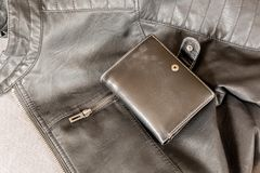 Leather jacket and a wallet Royalty Free Stock Photo
