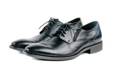 Stylish black leather men laced shoes. Isolated Stock Photos