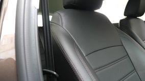 Stylish black leather seats in the car. beautiful leather car interior design. luxury leather seats in the car. Stylish black leather seats in car. beautiful stock video