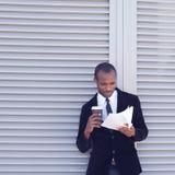 Stylish black man documents handling royalty free stock photos