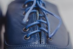 Stylish black mens crafted shoes for ballroom dancing. Stylish blue mens crafted shoes with laces from skin and suede. macro photography of crafted mens blue Stock Photography