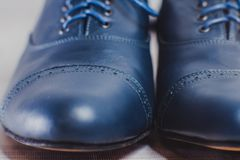 Stylish black mens crafted shoes for ballroom dancing. Stylish blue mens crafted shoes with laces from skin and suede. macro photography of crafted mens blue Royalty Free Stock Photos