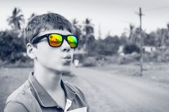 Stylish black and white portrait of charming guy in colorful mirror sunglasses Stock Photography