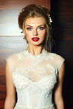 Stylish blond bride girl model in wedding dress. High fashion look. glamor closeup portrait of beautiful stylish blond bride young woman model with bright makeup royalty free stock photos