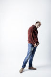 Stylish blond man in sweater, scarf and jeans Royalty Free Stock Photo