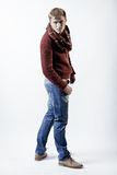 Stylish blond man in sweater, scarf and jeans Royalty Free Stock Image