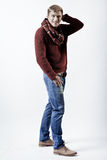 Stylish blond man in sweater, scarf and jeans Royalty Free Stock Photos