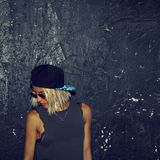 Stylish blonde in fashionable glasses and a cap. Urban fashion s Stock Photography