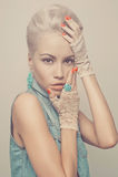 Stylish blonde. Fashionable photo of young stylish blonde in denim vest Stock Photo