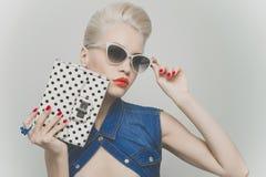 Stylish blonde. Fashionable photo of young stylish blonde in denim vest Royalty Free Stock Photos