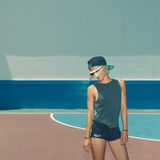 Stylish blonde on the football field. Urban style.  Royalty Free Stock Photography