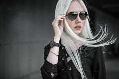 Stylish blonde girl in sunglasses outdoors Stock Photos