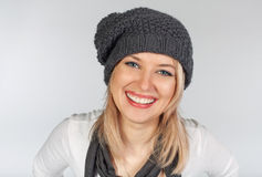 Stylish blonde girl in winter wool hat Stock Images